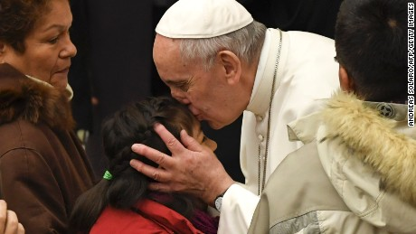Pope Francis (C) kisses a child during a general audience at the Paul VI Audience Hall at the Vatican on February 8, 2017.  / AFP / ANDREAS SOLARO        (Photo credit should read ANDREAS SOLARO/AFP/Getty Images)