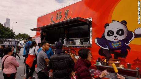 "Bao & Buns food truck -- an extension of Los Angeles-based Book Brothers -- prepares American-Chinese fusion bao. Stuffed with barbecued duck, chicken, beef or pork, these fluffy white steamed buns drew a curious crowd around the fiery red vehicle.  ""I learned about food truck culture in Los Angeles, and I wanted to promote that in Asian countries, starting in Hong Kong,"" says Bao & Buns operator Raymond Wong. ""After that, we are thinking about expanding into China and Southeast Asia, because food truck culture really doesn't exist in this region yet."""