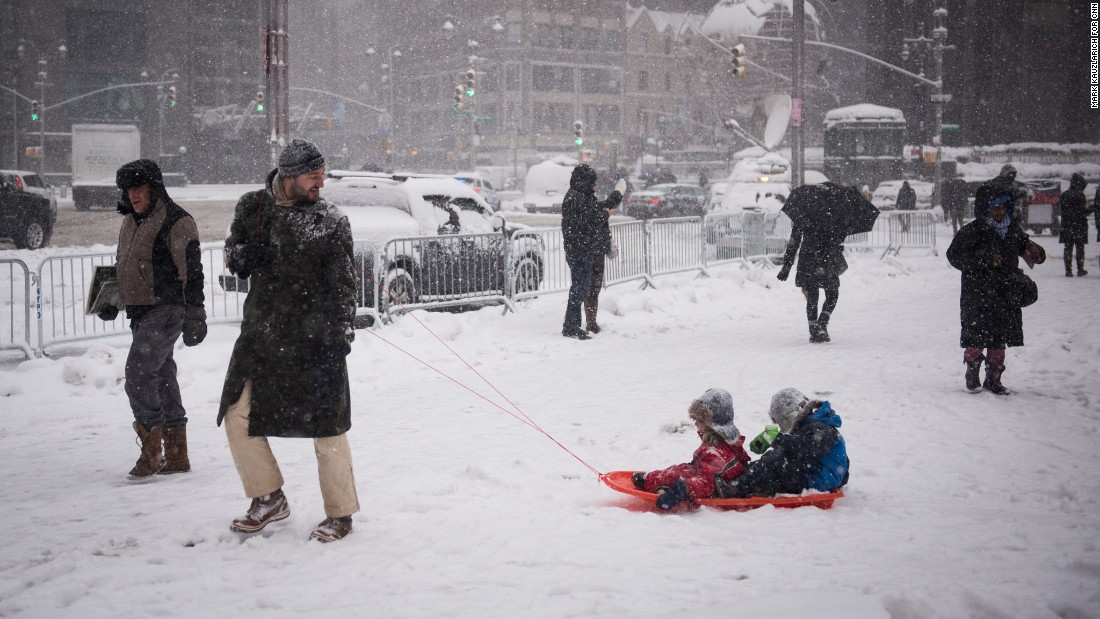 Andrea De Donno pulls a sled carrying his children after they played in New York's Central Park on February 9.