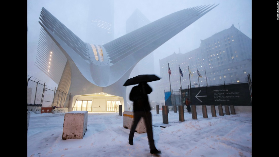 A man in New York walks past the Oculus of the World Trade Center Transportation Hub.