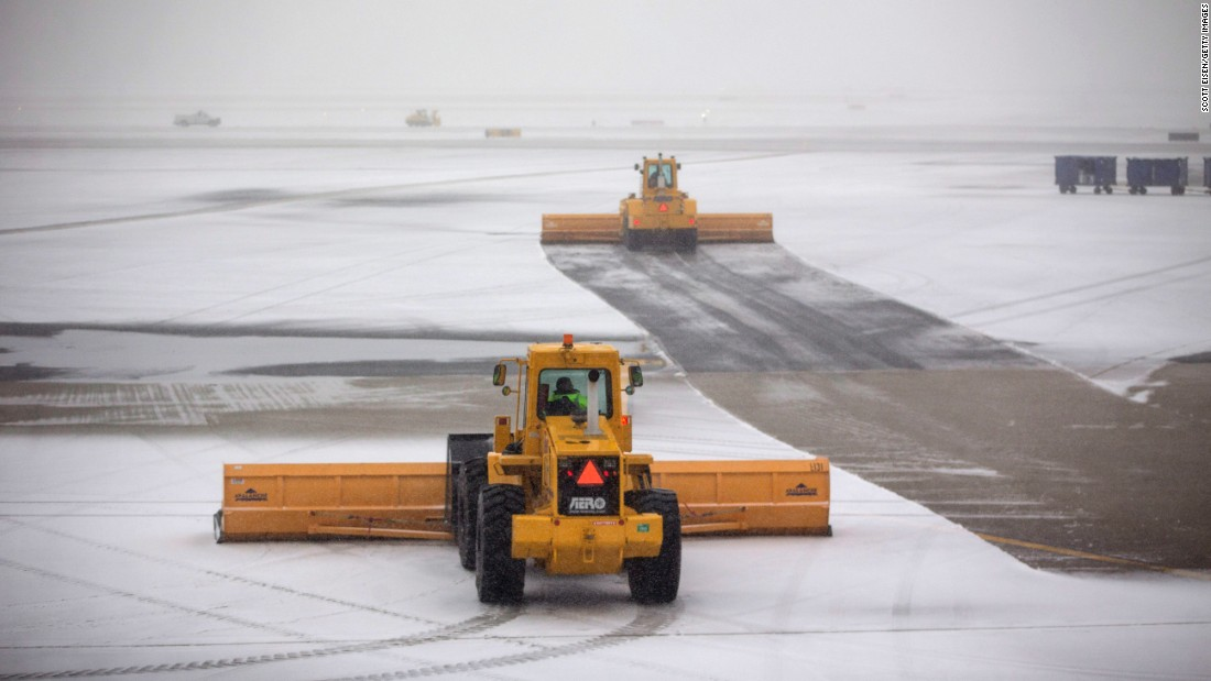 Crews plow snow at Boston's Logan International Airport.