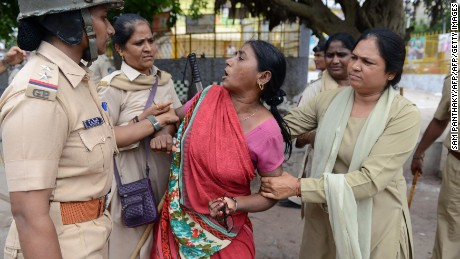 A member of the Dalit caste community is detained during a protest against an earlier attack on Dalits in July, 2016.