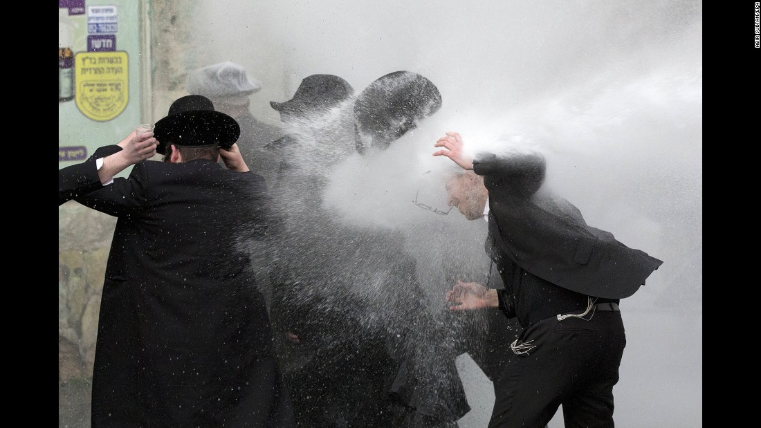 Israeli police use water cannons to disperse ultra-Orthodox Jewish demonstrators in Jerusalem on Thursday, February 9. Thousands of protesters were blocking roads in various locations as they called for the release of a student who was arrested after refusing to join the army.