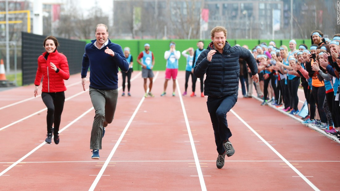 Britain's Prince Harry, right, leads his brother, William, and his sister-in-law, Kate, during a relay race in London promoting the Heads Together charity on Sunday, February 5.