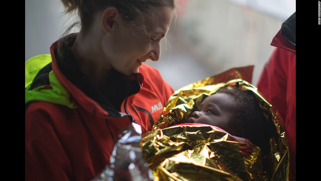"Volunteer Laura Rasero holds Ivorian migrant Oulai Esther after a Spanish group rescued a rubber boat sailing out of control in the Mediterranean Sea on Friday, February 3. <a href=""http://www.cnn.com/2015/09/03/world/gallery/europes-refugee-crisis/index.html"" target=""_blank"">Europe's migration crisis in 25 photos</a>"