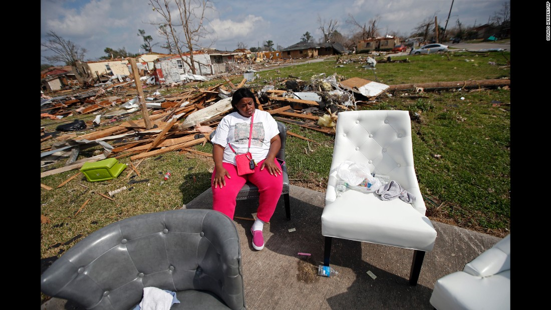 "Sheila Jefferson sits outside a relative's home on Wednesday, February 8, after <a href=""http://www.cnn.com/2017/02/07/us/gallery/tornado-new-orleans-0207/index.html"" target=""_blank"">a tornado</a> tore through part of New Orleans."