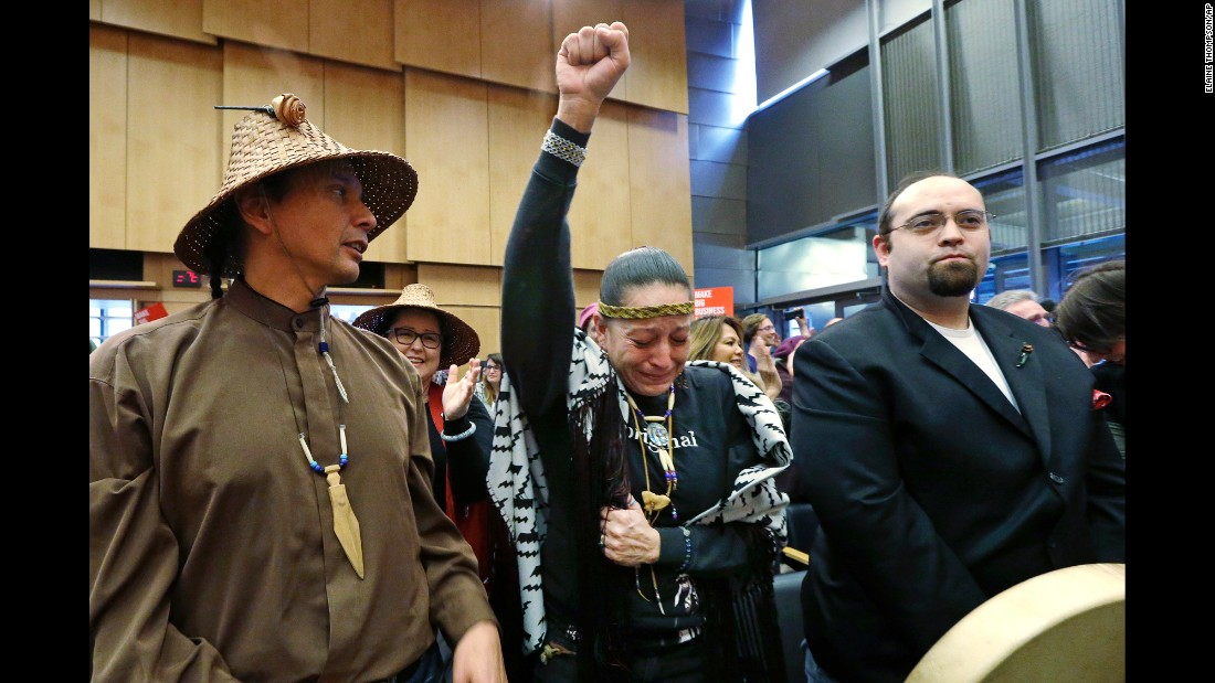"""Olivia One Feather holds up her fist and cries tears of happiness on Tuesday, February 7, after the Seattle City Council voted in favor of cutting banking ties with Wells Fargo and avoiding any new investments in the company's stocks and bonds. <a href=""""http://money.cnn.com/2017/02/08/investing/seattle-wells-fargo-dakota-access-pipeline/"""" target=""""_blank"""">Seattle's breakup with Wells Fargo</a> was mostly driven by anger over the bank's role as one of more than a dozen lenders helping to finance the controversial Dakota Access Pipeline. The oil pipeline has been given the green light by President Trump, despite fierce opposition from Native Americans and environmentalists."""