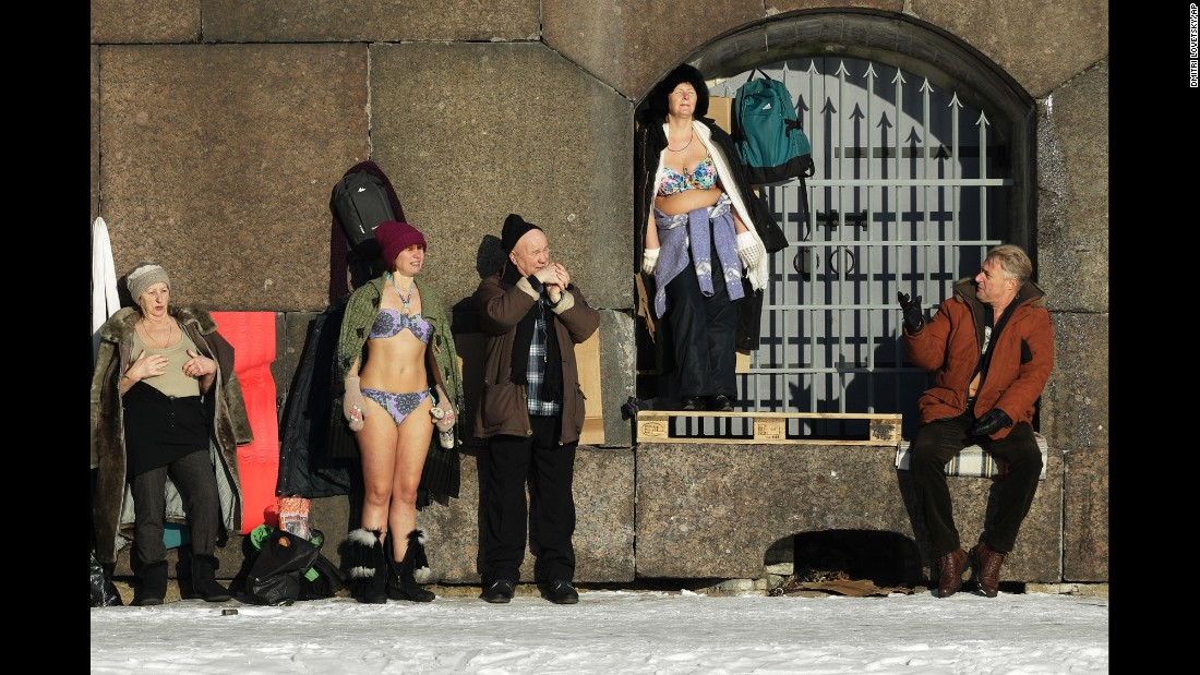 People sunbathe near the wall of the Peter and Paul Fortress in St. Petersburg, Russia, on Tuesday, February 7. The temperature was minus-12 degrees Celsius (10 degrees Fahrenheit).