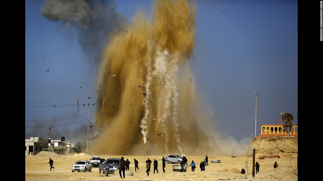 People in northern Gaza run for cover after an Israeli airstrike targeted a Hamas post on Monday, February 6. Israel struck a number of Hamas positions after a projectile from Gaza crashed into a border area, the Israeli army said.