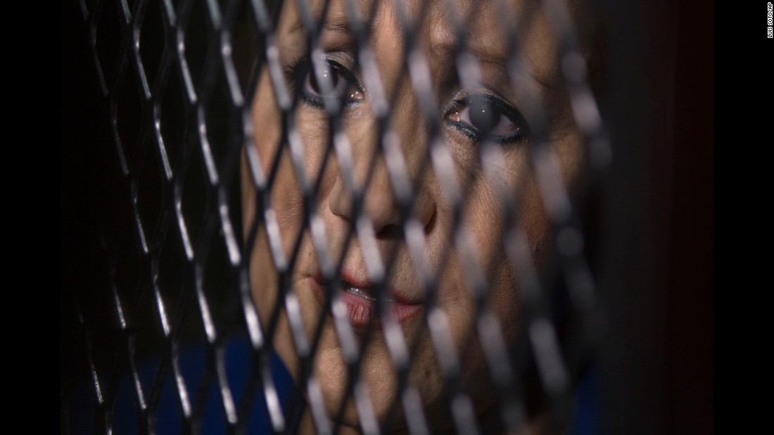 Guatemala Supreme Court Justice Blanca Stalling looks out from a cell at a court in Guatemala City on Wednesday, February 8. Prosecutors say she was arrested on a charge of influence peddling after she tried to help her son in a corruption case. She has denied the accusation.