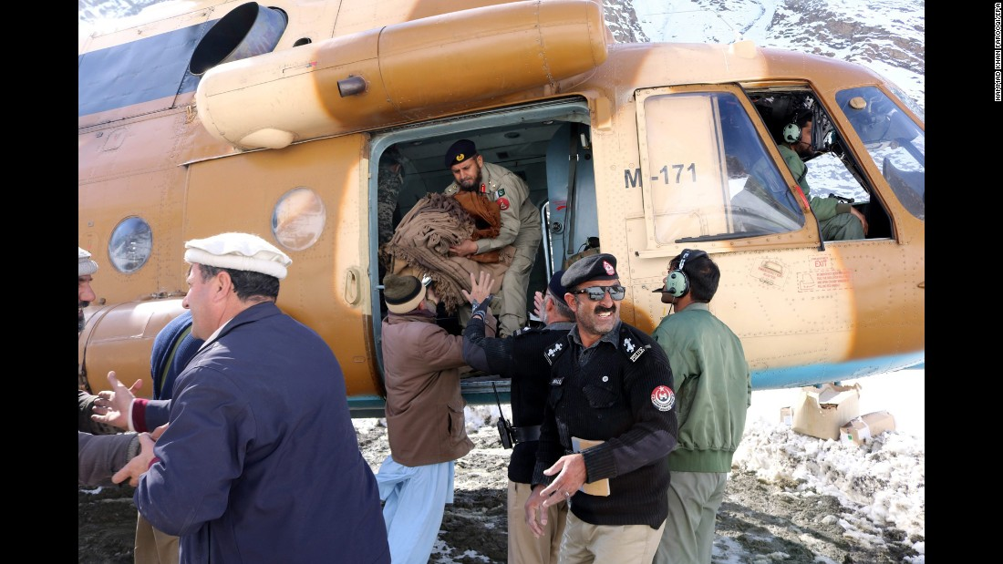 "Relief goods are distributed after an avalanche in Chitral, Pakistan, on Monday, February 6. At least 156 people have died along the Afghan-Pakistani border after three days of heavy snowfall <a href=""http://www.cnn.com/2017/02/06/asia/avalanche-afghanistan-pakistan/"" target=""_blank"">caused a series of deadly avalanches.</a>"