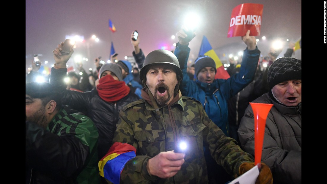 "People protest against the government in Bucharest, Romania, on Monday, February 6. Romanian Justice Minister Florin Iordache <a href=""http://www.cnn.com/2017/02/09/europe/romania-justice-minister-resigns/"" target=""_blank"">resigned a few days later</a> over a controversial government decree that would have protected many politicians from being prosecuted for corruption offenses."