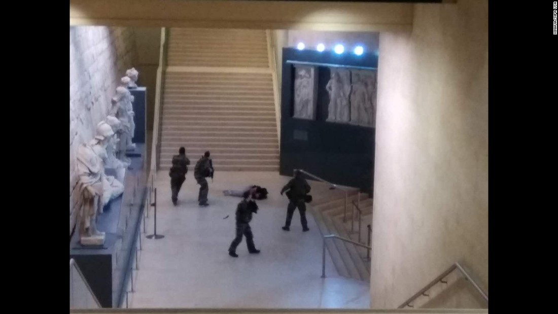 "This cell phone photo, taken by a tourist, shows a soldier opening fire on a man at the Louvre museum in Paris on Friday, February 3. The man, wielding a machete, <a href=""http://www.cnn.com/2017/02/03/europe/france-paris-louvre-incident/"" target=""_blank"">had rushed toward a group of soldiers and guards</a> in the Carrousel du Louvre, the underground plaza adjoining the museum, according to Paris police Chief Michel Cadot. French authorities opened a terror investigation."