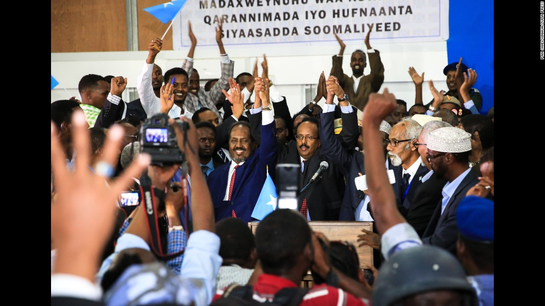 "Somalia's new president, Mohamed Abdullahi Farmajo, raises his hands with outgoing President Hassan Sheikh Mohamud, left, in Mogadishu, Somalia, on Wednesday, February 8. The country's parliament elected Farmajo, a dual US-Somali citizen, <a href=""http://www.cnn.com/2017/02/08/africa/mohamed-abdullahi-farmajo-somalia-election/"" target=""_blank"">after Mohamud dropped out of the contest</a> after the second round of voting."