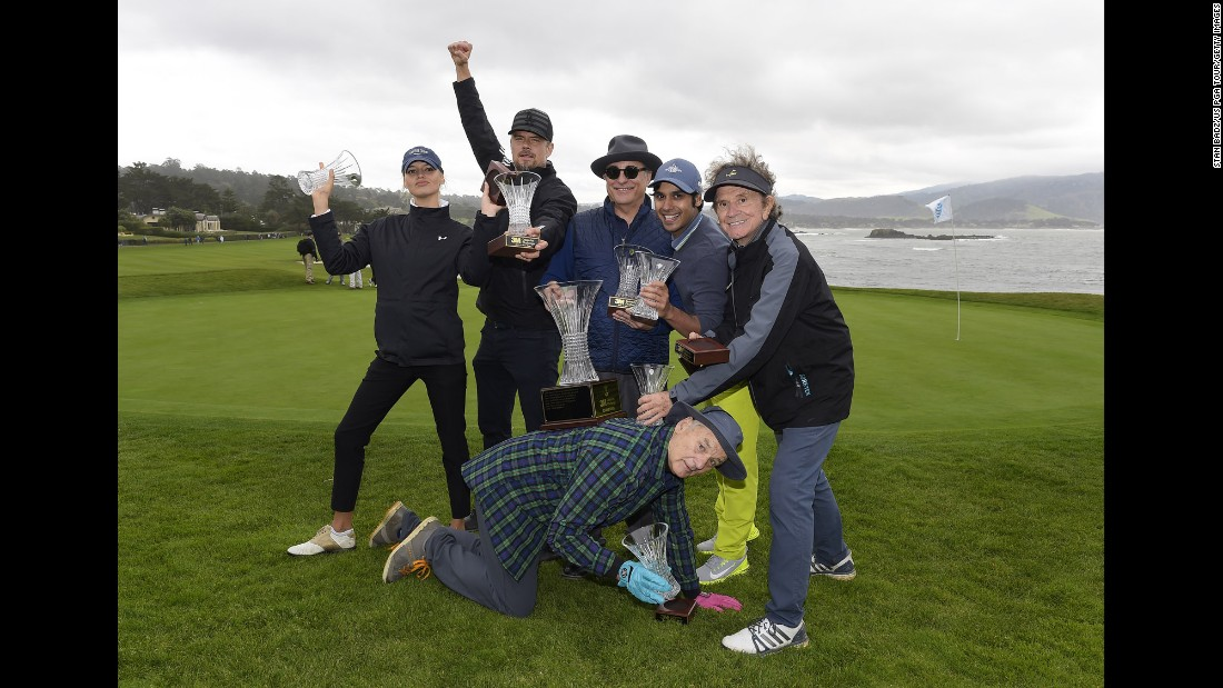 Actor Bill Murray, bottom, poses with other members of his golf team after they won a celebrity tournament in Pebble Beach, California, on Wednesday, February 8. From left are Kelly Rohrbach, Josh Duhamel, Andy Garcia, Kunal Nayyar and Gary Mule Deer.