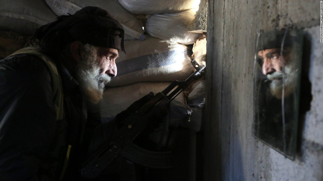 Mahmoud Al-Khatib, a Syrian rebel fighter, holds a position in Al-Bilaliyah, Syria, on Saturday, February 4.