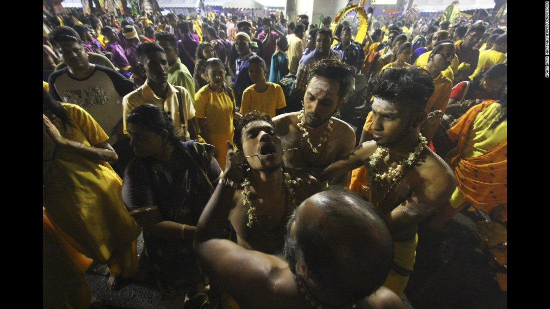 A Hindu devotee is in a state of trance during Thaipusam celebrations in Kuala Lumpur, Malaysia, on Thursday, February 9. During the festival, many people show their devotion by piercing their bodies with tridents, hooks and skewers.