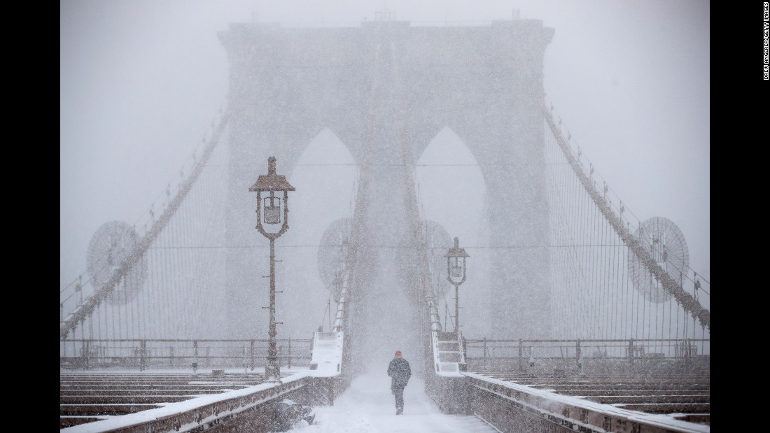 "A man walks across the Brooklyn Bridge in New York during <a href=""http://www.cnn.com/2017/02/09/us/gallery/northeast-snowstorm/index.html"" target=""_blank"">a snowstorm</a> on Thursday, February 9. <a href=""http://www.cnn.com/2017/02/02/world/gallery/week-in-photos-0203/index.html"" target=""_blank"">See last week in 29 photos</a>"