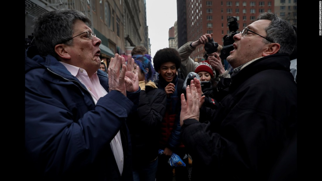 "A demonstrator in New York, left, argues with a supporter of US President Donald Trump during a protest against Trump's immigration policies on Tuesday, February 7. Trump <a href=""http://www.cnn.com/2017/02/06/politics/trump-travel-ban-update/"" target=""_blank"">signed an executive order</a> that would temporarily suspend the admission of refugees and bar entry to the United States from seven Muslim-majority countries."