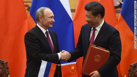 Putin and Xi shake hands during a meeting in Beijing in June 2016.