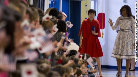 Then-First Lady  Michelle Obama and  Akie Abe meet students during a tour of the Great Falls Elementary School in Great Falls, Virginia on April 28, 2015.