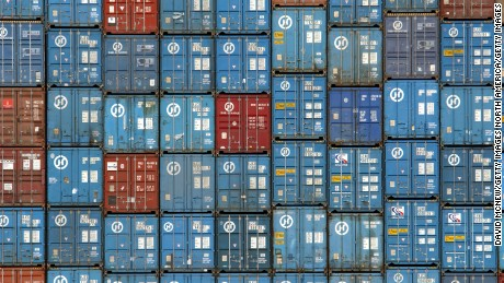 """403123 07: Thousands of truck-sized 30-ton shipping containers are stacked aboard the Hanjin Oslo freighter in the Port of Los Angeles March 29, 2002 in Los Angeles, CA. Freigters in the port, averaging 800 feet in length and carrying 4,000 containers, will be replaced with ships over 1,000 feet long that can carry 6,600 containers. By the end of the year, the nation's busiest port will become """"super-sized"""" with ever more massive cranes, freighters, and tug boats to meet the insatiable American appetite for cheap imported goods. (Photo by David McNew/Getty Images)"""