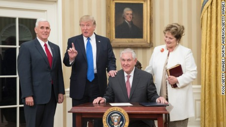 WASHINGTON, DC - FEBRUARY 1:  (AFP OUT) U.S. President Donald Trump (2nd L) reacts after  Rex Tillerson (seated), accompanied by wife Renda St. Clair, signed an appointment affidavit after being sworn in as the 69th secretary of state by Vice President Mike Pence (L) in the Oval Office of the White House on February 1, 2017 in Washington, DC. Tillerson was confirmed by the Senate earlier in the day in a 56-43 vote.  (Photo by Michael Reynolds-Pool/Getty Images)