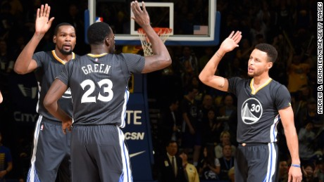 RESTRICTED OAKLAND, CA - DECEMBER 17: Draymond Green #23, Stephen Curry #30, Kevin Durant #35 and Klay Thompson #11 of the Golden State Warriors high five each other during the game against the Portland Trail Blazers on December 17, 2016 in Oakland, California. NOTE TO USER: User expressly acknowledges and agrees that, by downloading and/or using this Photograph, user is consenting to the terms and conditions of the Getty Images License Agreement. Mandatory Copyright Notice: Copyright 2016 NBAE (Photo by Andrew D. Bernstein/NBAE via Getty Images)