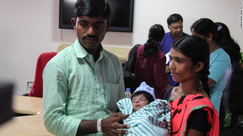 The boy with his mother Lalitamma, 23, and father Chennabasava, 26.
