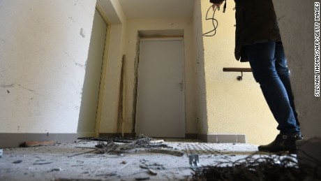 Debris lies outside an apartment after an explosion during a raid by French anti-terrorist police in Clapiers, near Montpellier, in southern France, on Friday, February 10. Sylvain Thomas/AFP/Getty Images