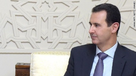 A handout picture released by the official Syrian Arab News Agency (SANA) on February 8, 2017 shows Syrian President Bashar al-Assad (R) meeting with a delegation from the Russian Duma, headed by Federation Council member Dmitry Sablin. / AFP PHOTO / SANA / HOHO/AFP/Getty Images