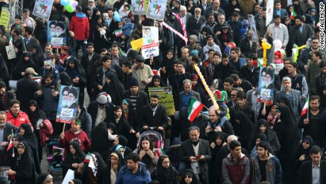 Iranians march on Friday.