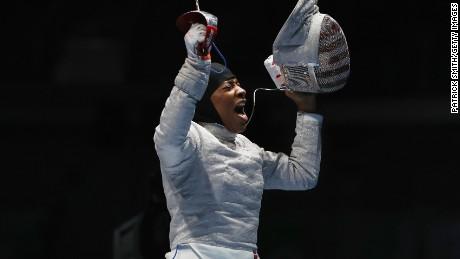 Ibtihaj Muhammad celebrates victory over Olena Kravatska of Ukraine during on Day 3 of the Rio 2016 Olympics.