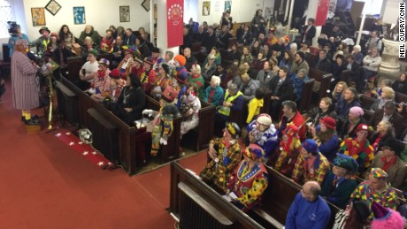 Clowns line the rows of All Saints church in east London.