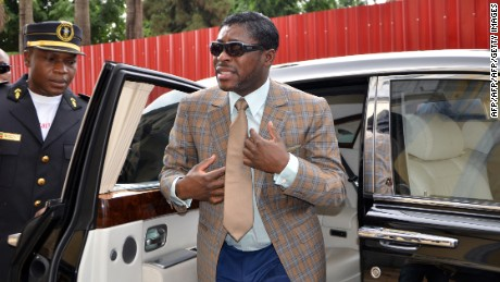 A picture taken on June 25, 2013 shows Teodorin Nguema Obiang (R), the son of Equatorial Guinea's president Teodoro Obiang and the country's vice-president in charge of security and defence, arriving at Malabo's Cathdral to celebrate his 41st birthday. AFP PHOTO / JEROME LEROY        (Photo credit should read JEROME LEROY/AFP/Getty Images)