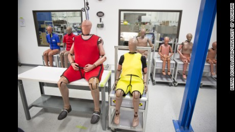 The new obese crash-test dummy (left) sits beside an older, normal-sized dummy.