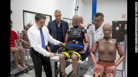 "Dr. Stewart Wang demonstrates how to secure an ""elderly"" crash-test dummy."