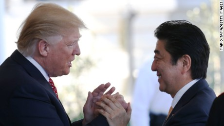 WASHINGTON, DC - FEBRUARY 10:  President Donald Trump (L) greets Japan's Prime Minister Shinzo Abe as he arrives at the White House on February 10, 2017 in Washington, DC. The two will hold a bilateral meeting and press conference today at the White House.  (Photo by Mario Tama/Getty Images)