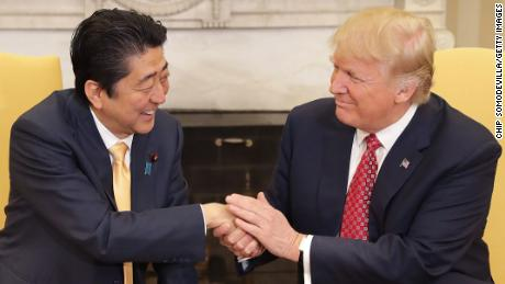 Trump shakes Japanese PM's hand for 19 seconds