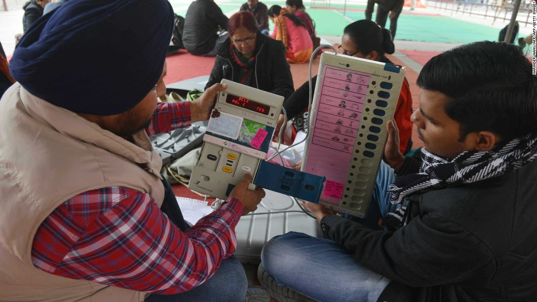 Indian election officials examine Electronic Voting Machines (EVM) at a distribution centre in Amritsar on February 3. The final count is on March 11, after a seven-phase voting period.