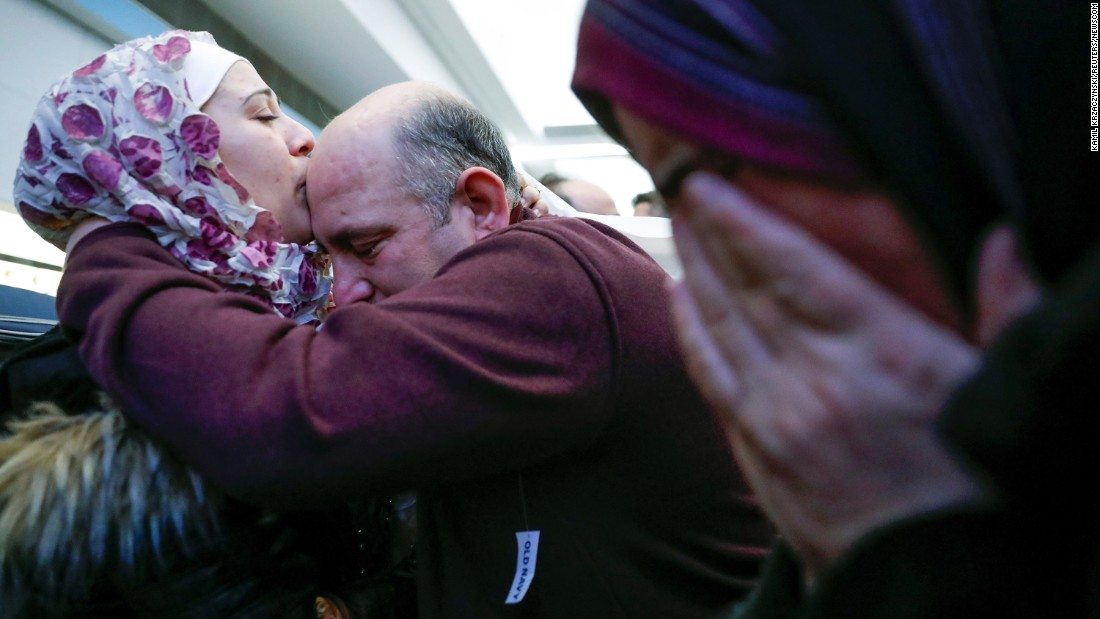 "Syrian refugee Baraa Haj Khalaf kisses her father, Khaled, after arriving at Chicago's O'Hare International Airport on Tuesday, February 7. She arrived with her partner and their 16-month-old daughter after being told last week that they couldn't fly to the United States because of an executive order signed by President Donald Trump. That order, which temporarily suspended the admission of refugees and barred entry to the United States from seven Muslim-majority countries, was blocked by a federal judge. A federal appeals court <a href=""http://www.cnn.com/2017/02/09/politics/travel-ban-9th-circuit-ruling-immigration/index.html"" target=""_blank"">upheld the ruling</a> on Thursday, February 9."