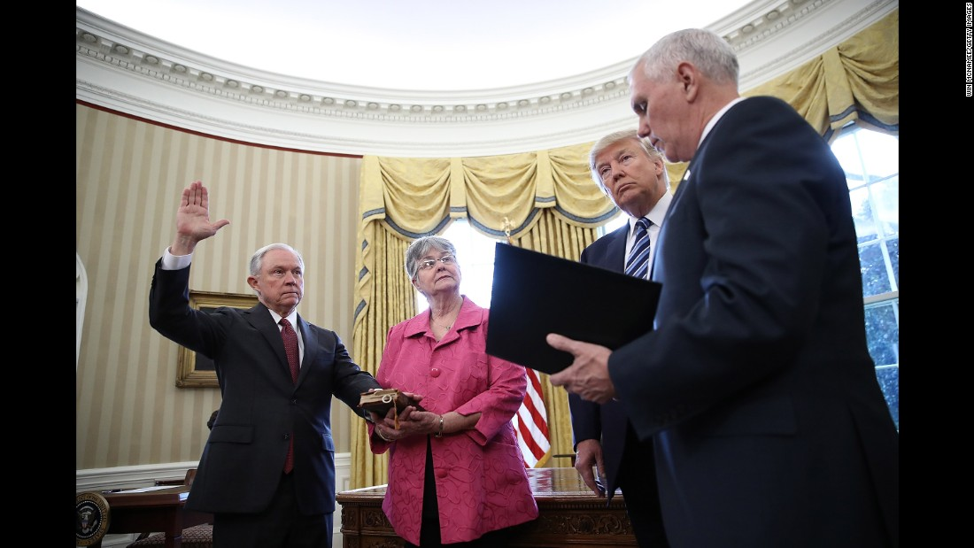 "President Trump watches as Vice President Pence administers the oath of office to Attorney General Jeff Sessions on Thursday, February 9. Sessions, one of Trump's closest advisers and his earliest supporter in the Senate, <a href=""http://www.cnn.com/2017/02/08/politics/jeff-sessions-vote-senate-slog/"" target=""_blank"">was confirmed by a 52-47 vote</a> that was mostly along party lines. He was accompanied at the swearing-in by his wife, Mary."