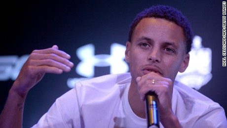 "National Basketball Association (NBA) Golden State Warriors and 2014-2015 season Most Valuable Player (MVP) Stephen Curry gestures during a press conference in Manila on September 5, 2015. Curry started his three-nation (Japan, China and Philippines) Under Armour Asia tour to promote the company's limited edition basketball shoes, ""UA Curry II"". AFP PHOTO /  NOEL CELIS        (Photo credit should read NOEL CELIS/AFP/Getty Images)"