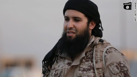 """(FILES) This image grab taken on September 11, 2016 from a propaganda video released by the Islamic State (IS) group media office in Iraq's Nineveh province on July 20, 2016, allegedly shows Rachid Kassim, a French member of the Islamic State group (IS), speaking in French to the camera from an undisclosed location before beheading two men along with another jihadist. The father of French jihadist Rashid Kassim, who is suspected of having sent a threatening letter to a Lyon daily newspaper, was arrested on October 20, 2016 in Roanne in the French Loire department, according to a source close to the investigation. Mohamed Kassim was arrested in the morning by the police """"near his home"""" and was placed in custody in an undisclosed location, the source said, confirming a report by France Inter radio. His arrest comes as part of an ordinary investigation - and not because of terrorism - entrusted by the prosecutor of Roanne to the judicial police in Lyon. Rashid Kassim, who is considered as one of the most dangerous French propagandists of the Islamic State (IS), is suspected of coordinating attacks in France from the Syria-Iraq zone, where he has taken refuge. / AFP PHOTO / Welayat Nineveh / --/AFP/Getty Images"""