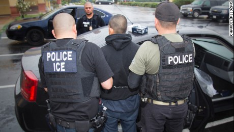 In this Tuesday, February 7, 2017, photo released by U.S. Immigration and Customs Enforcement shows foreign nationals being arrested this week during a targeted enforcement operation conducted by U.S. Immigration and Customs Enforcement aimed at immigration fugitives, re-entrants and at-large criminal aliens in Los Angeles.