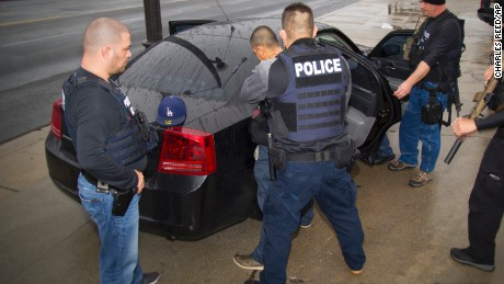 In this Tuesday, February 7, 2017, photo released by U.S. Immigration and Customs Enforcement shows foreign nationals being arrested this week during a targeted enforcement operation conducted by U.S. Immigration and Customs Enforcement (ICE) aimed at immigration fugitives, re-entrants and at-large criminal aliens in Los Angeles.
