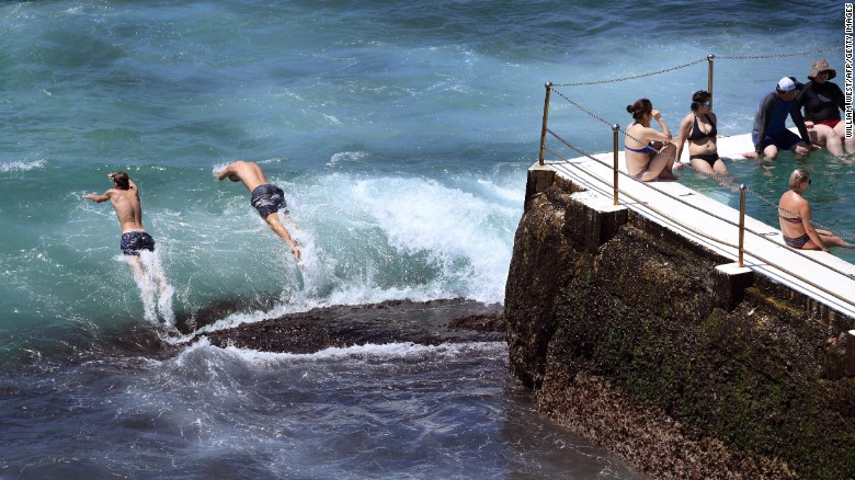 Swimmers jump into the surf at Sydney's Bondi Beach as the city swelters Saturday.