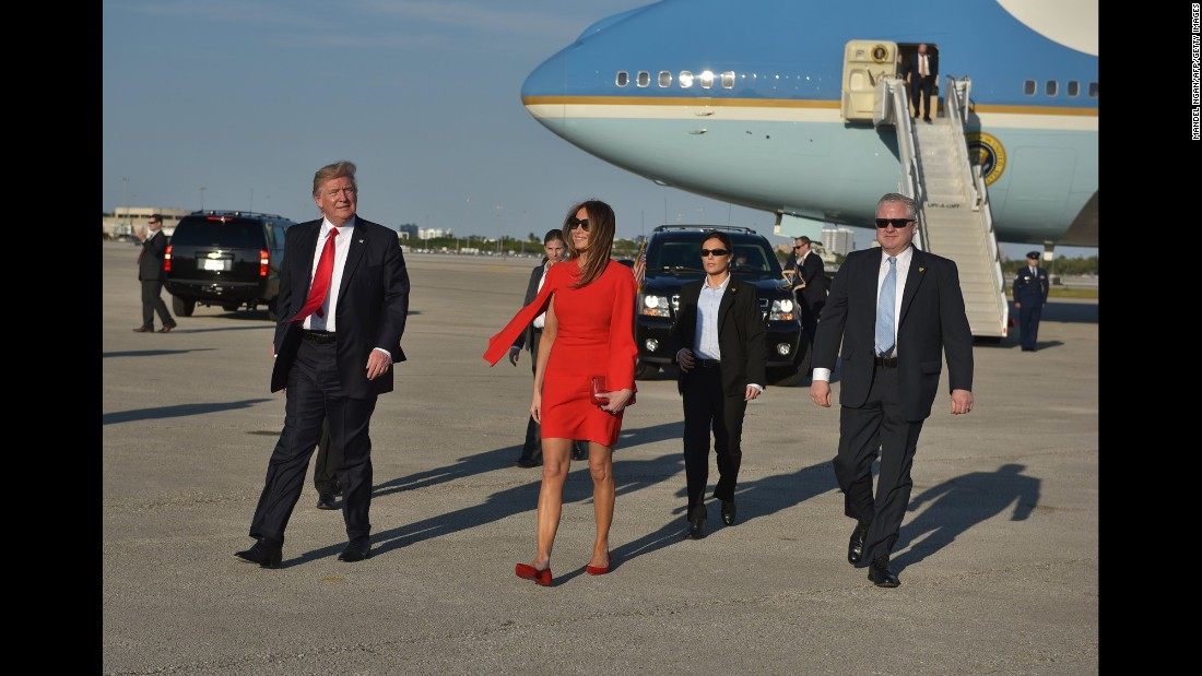 The first lady walks across the tarmac to greet well-wishers in West Palm Beach on Friday, February 3.