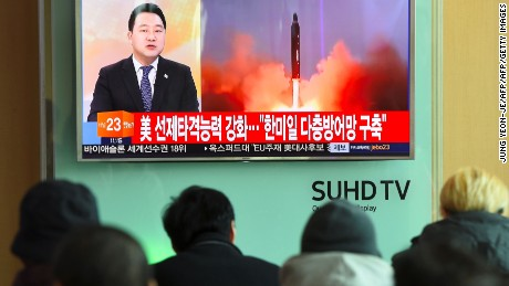 People at a railway station in Seoul, South Korea, watch the news showing file footage of a North Korean missile launch on February 12, 2017.