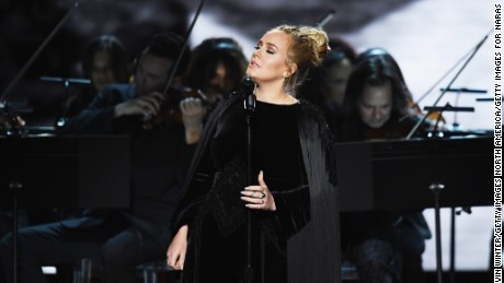 Adele performs a tribute to George Michael.